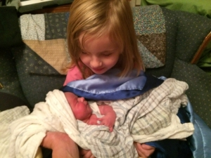 Ruby Holding Newborn Julian