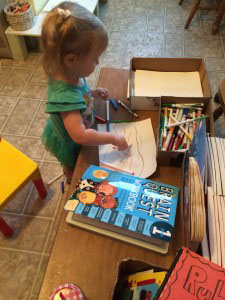 toddler standing and Coloring at a Little Coffee Table Learning Station