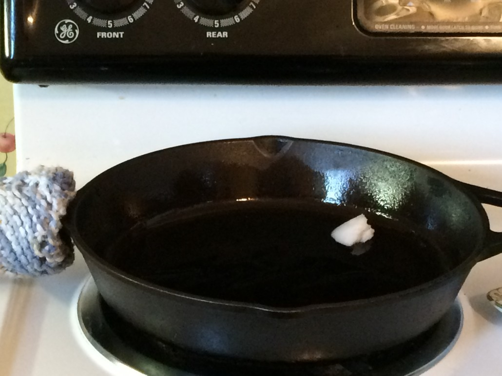Coconut Oil Melting on a Cast Iron Skillet