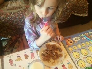 ruby_eating_yogurt_and_buttermilk_pancakes