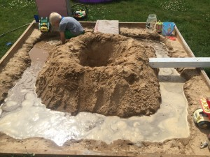Building a Volcano with a Moat in a sandbox