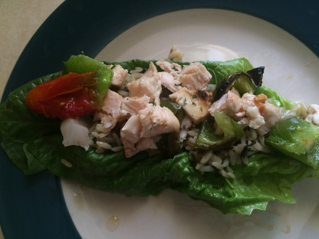 Cut Up Chicken Kebab on Rice in a Lettuce Wrap