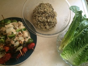 kabobs with rice and lettuce bowls