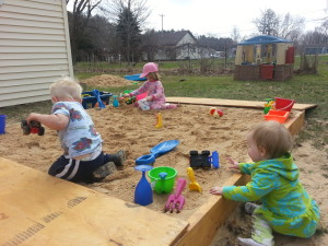 playing in the sandbox with a cover