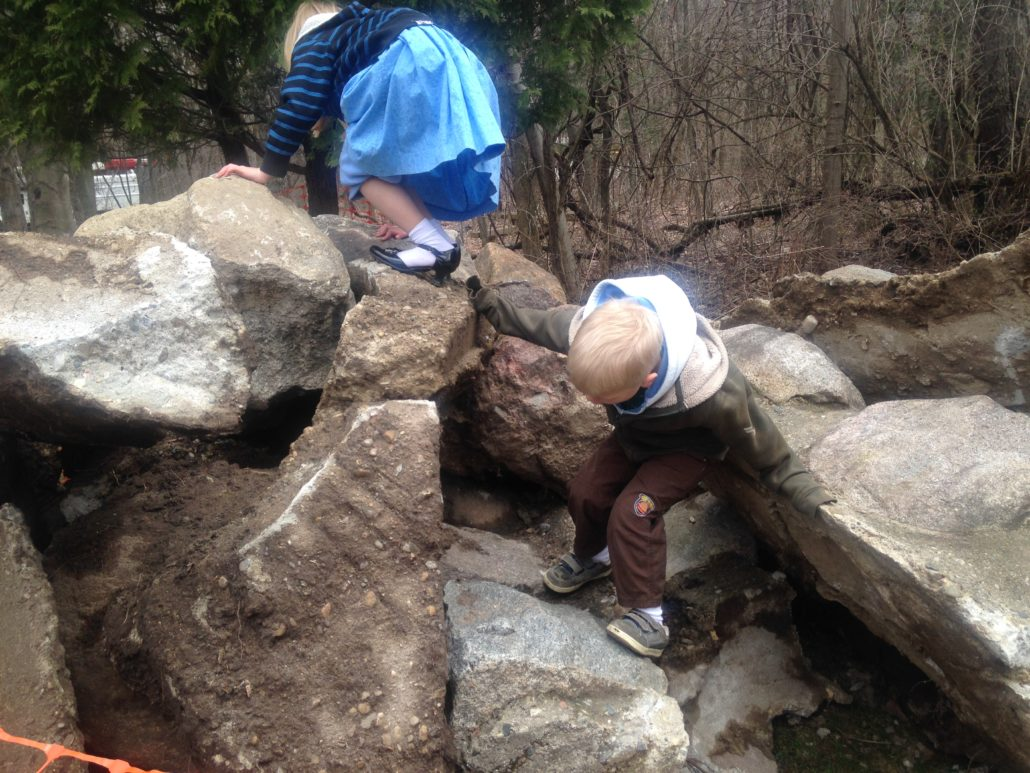 Ruby and Elliot Climbing on Rocks at Blandford Nature Center