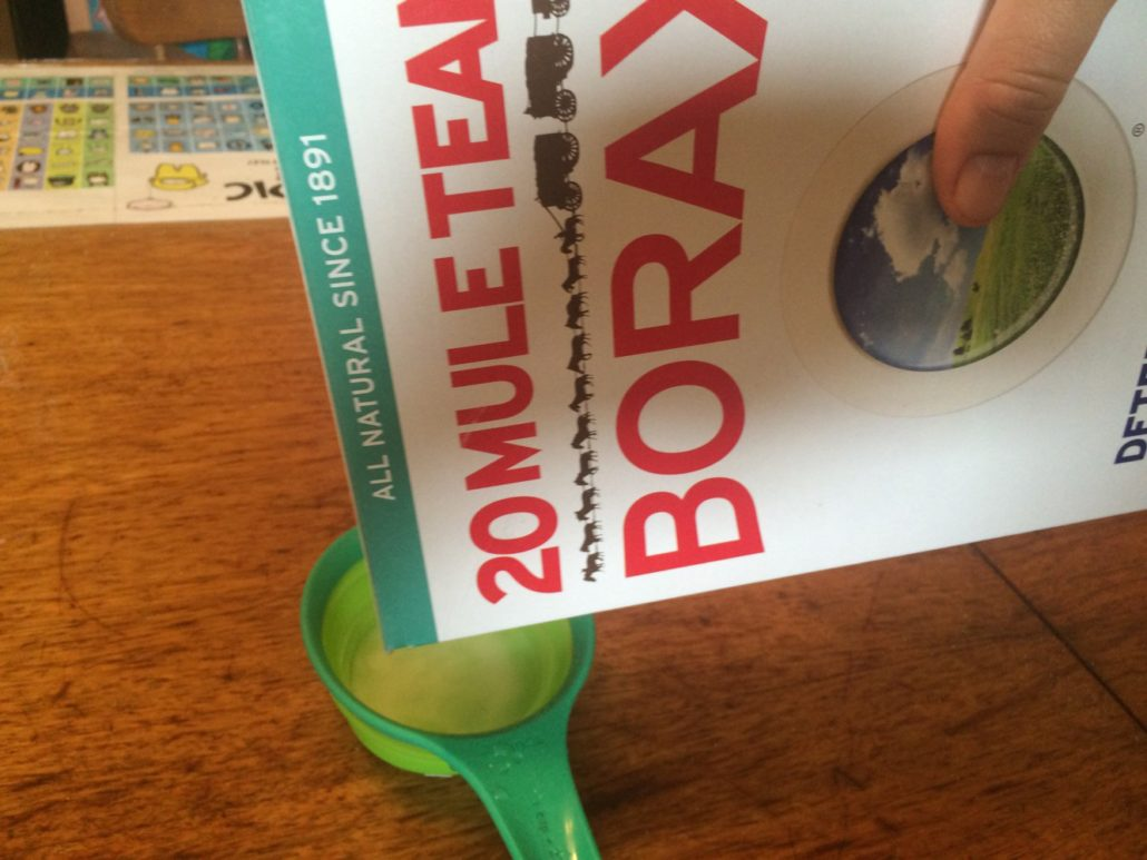 mixing borax and water for making slime putty