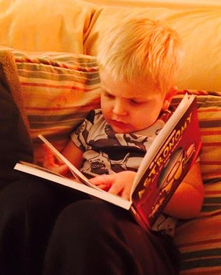 3 year old reading to himself