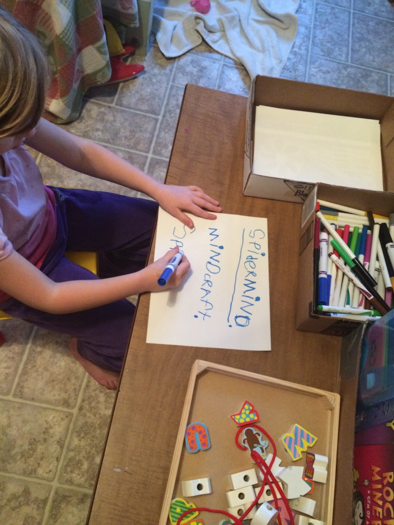 child Sitting and Writing at a Little Coffee Table Learning Station