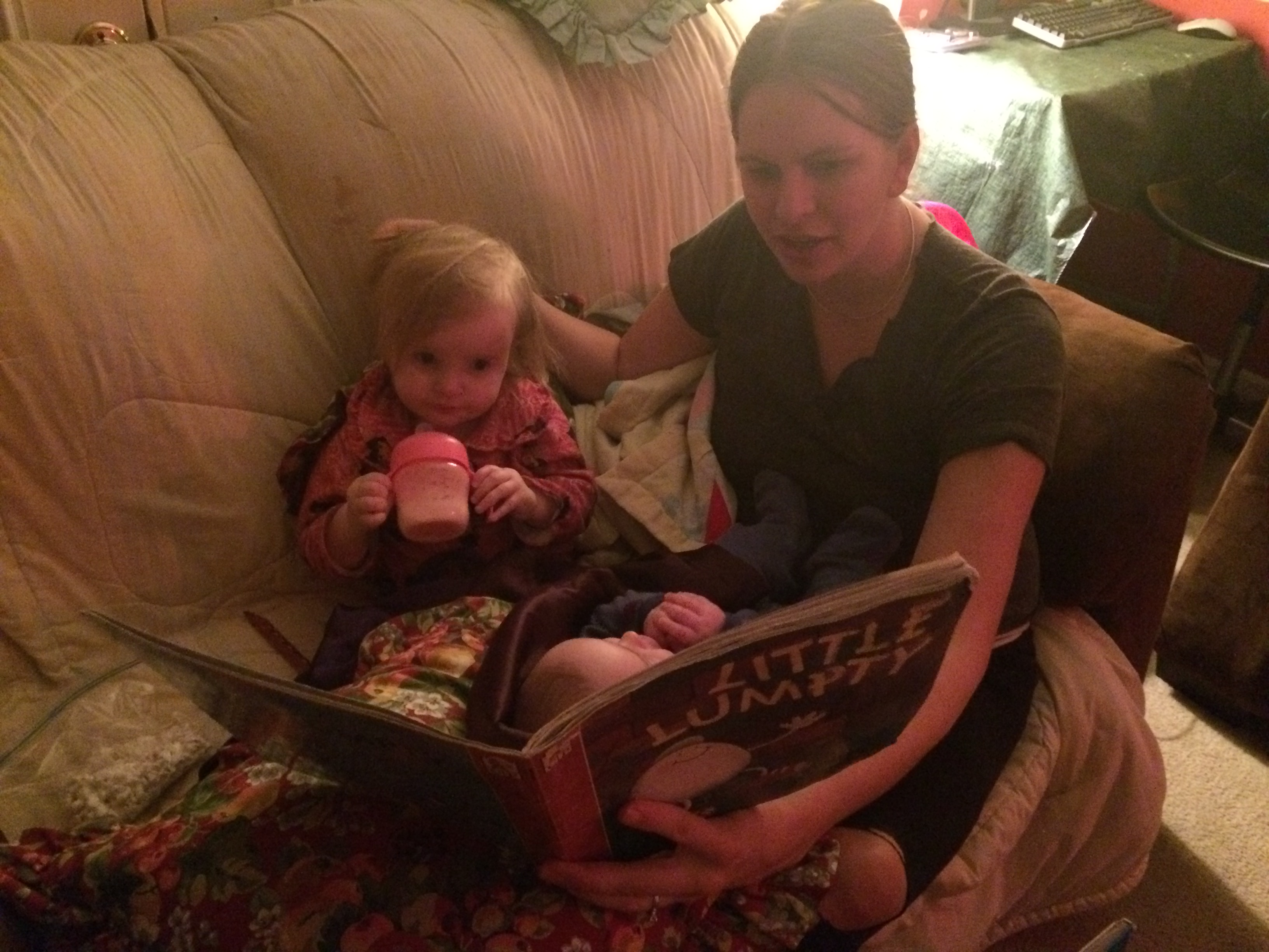 reading cuddled up with mommy and baby