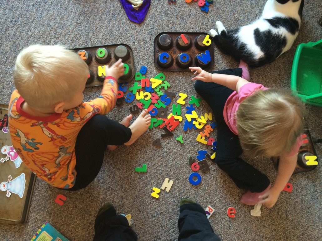 Elliot and Ophelia Play with Magnet Letters and Tins