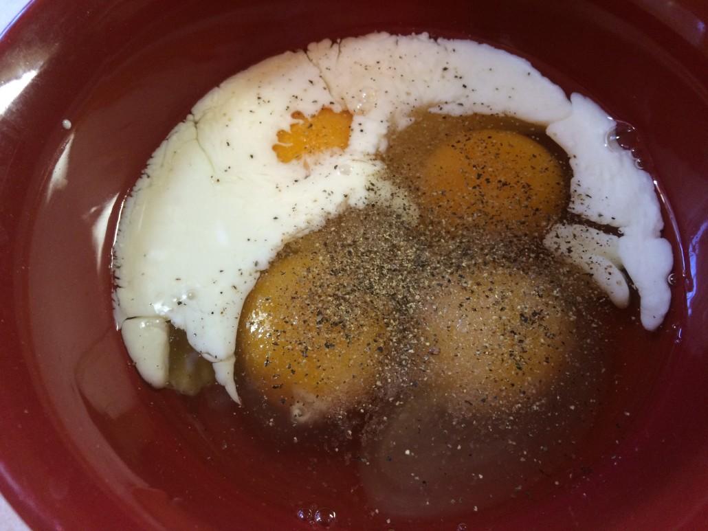 eggs, milk, salt, pepper ready to mix for scrambled eggs