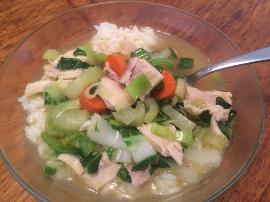 chicken soup over rice