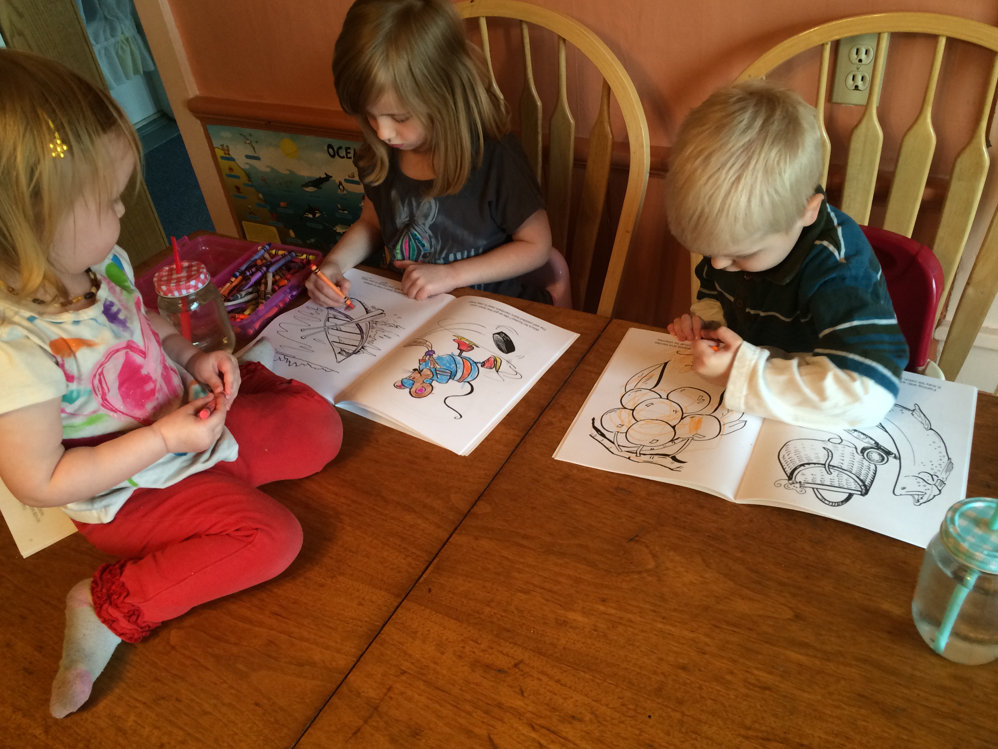 children coloring Michigan coloring books together