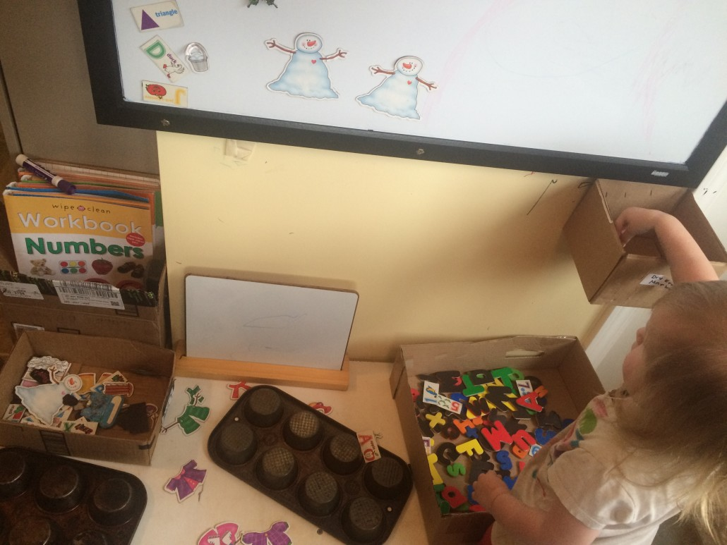 Ophelia Puts Magnetic Letters in a Box