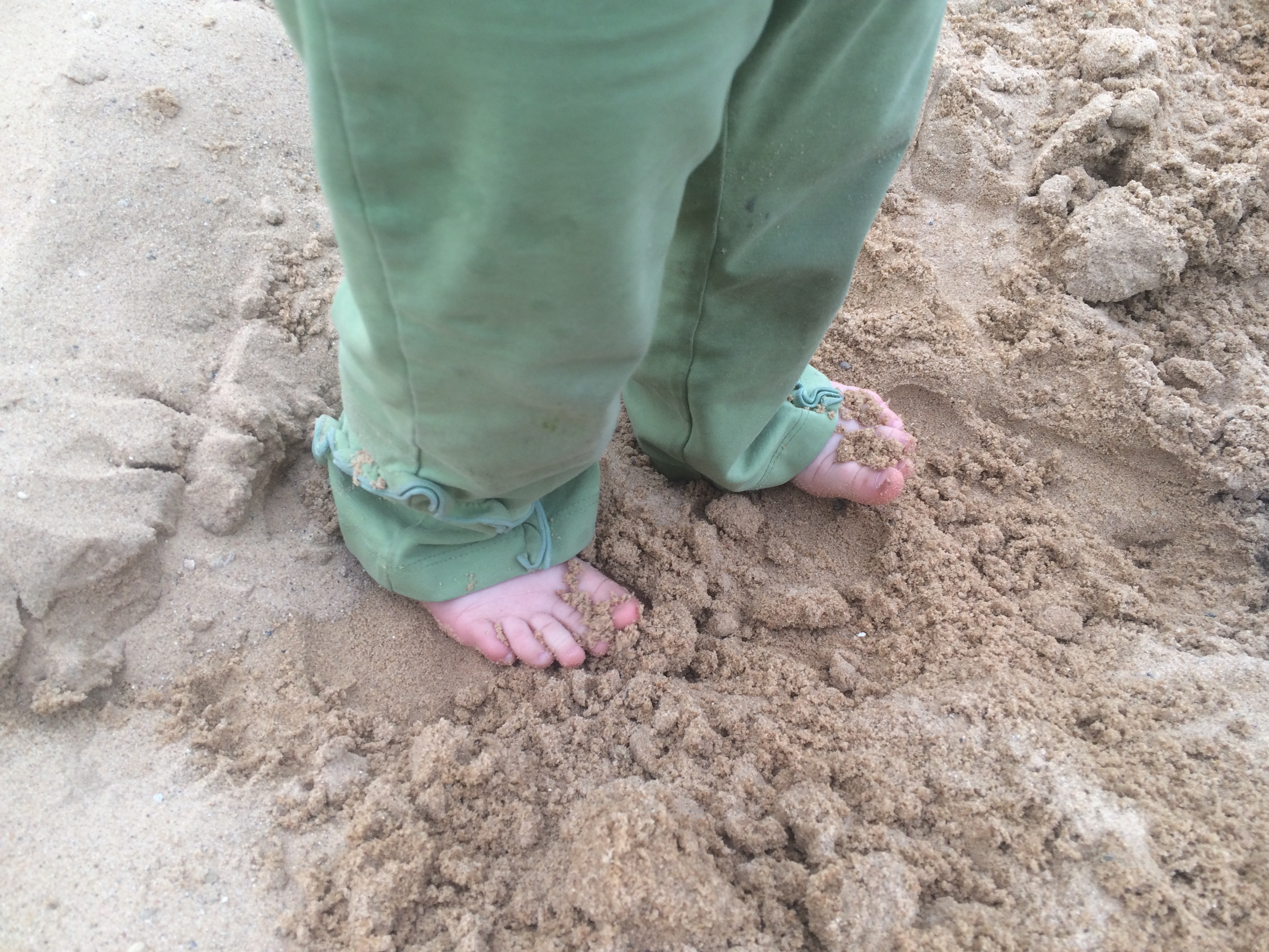 Ophelia Playing Barefoot in Our Sandbox