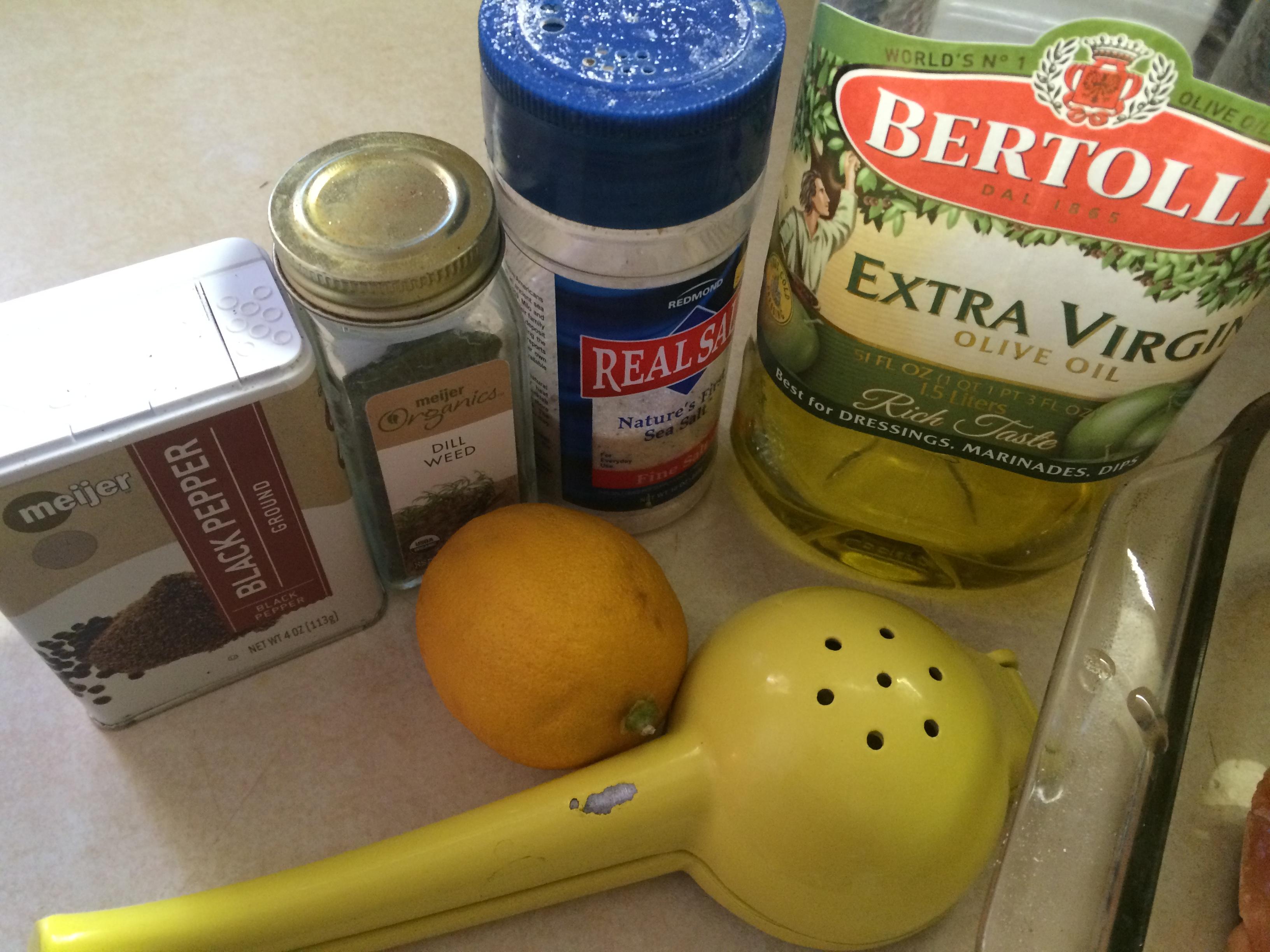 salt, pepper, dill, lemon, and extra virgin olive oil to bake wild caught salmon