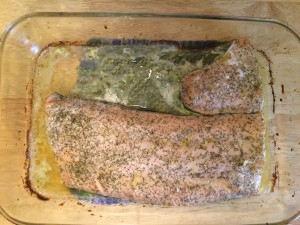 baked wild caught salmon with lemon, extra virgin olive oil, salt, pepper, and dill