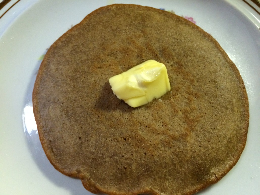 sourdough pancake fully cooked with a dollop of butter on the top