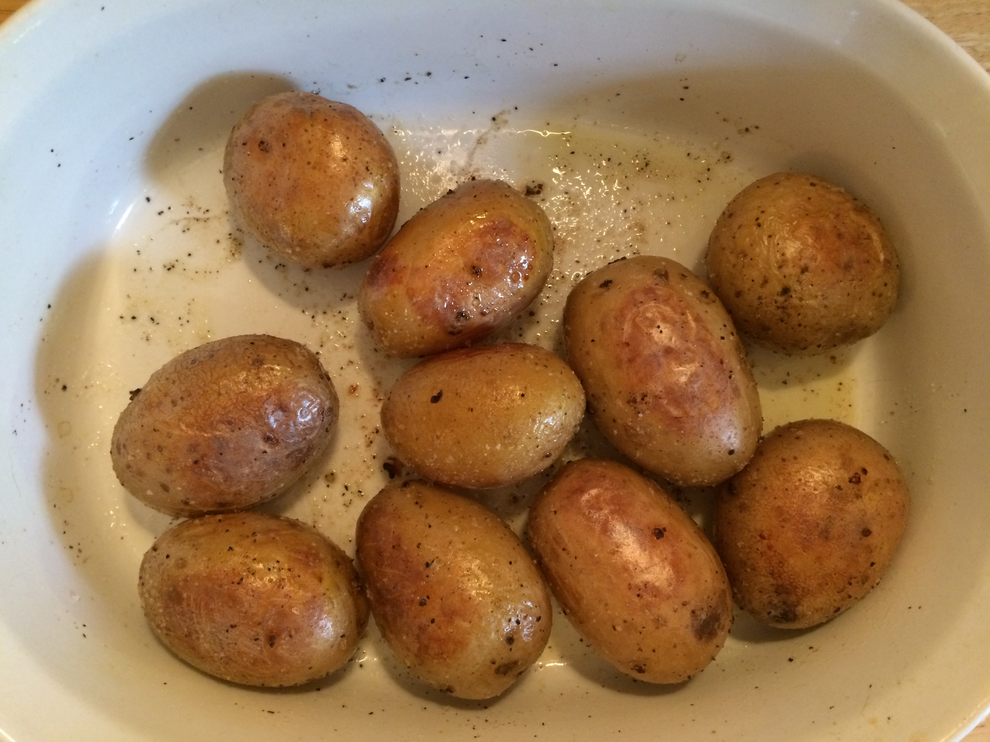 organic baked potatoes with olive oil, salt, and pepper