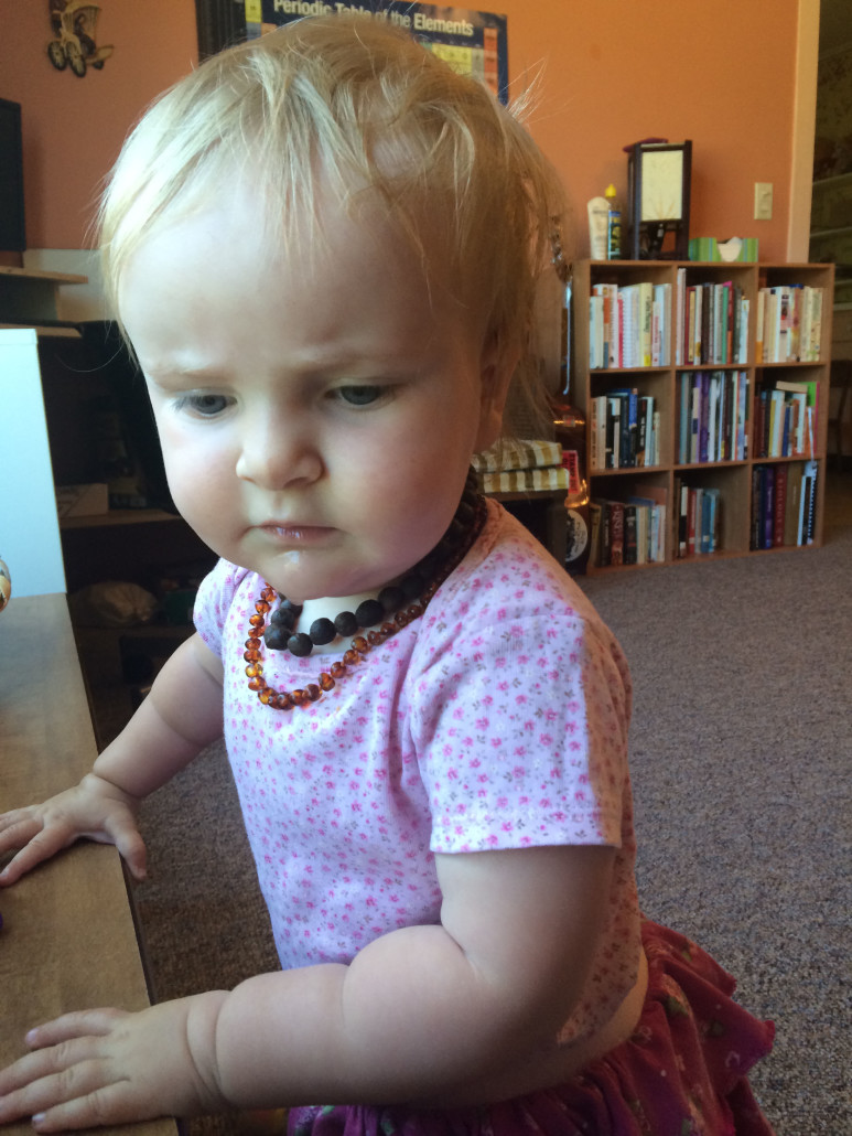 Ophelia Wearing Amber and Allspice Teething Necklaces