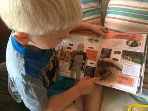 Elliot Reading a Star Wars Book