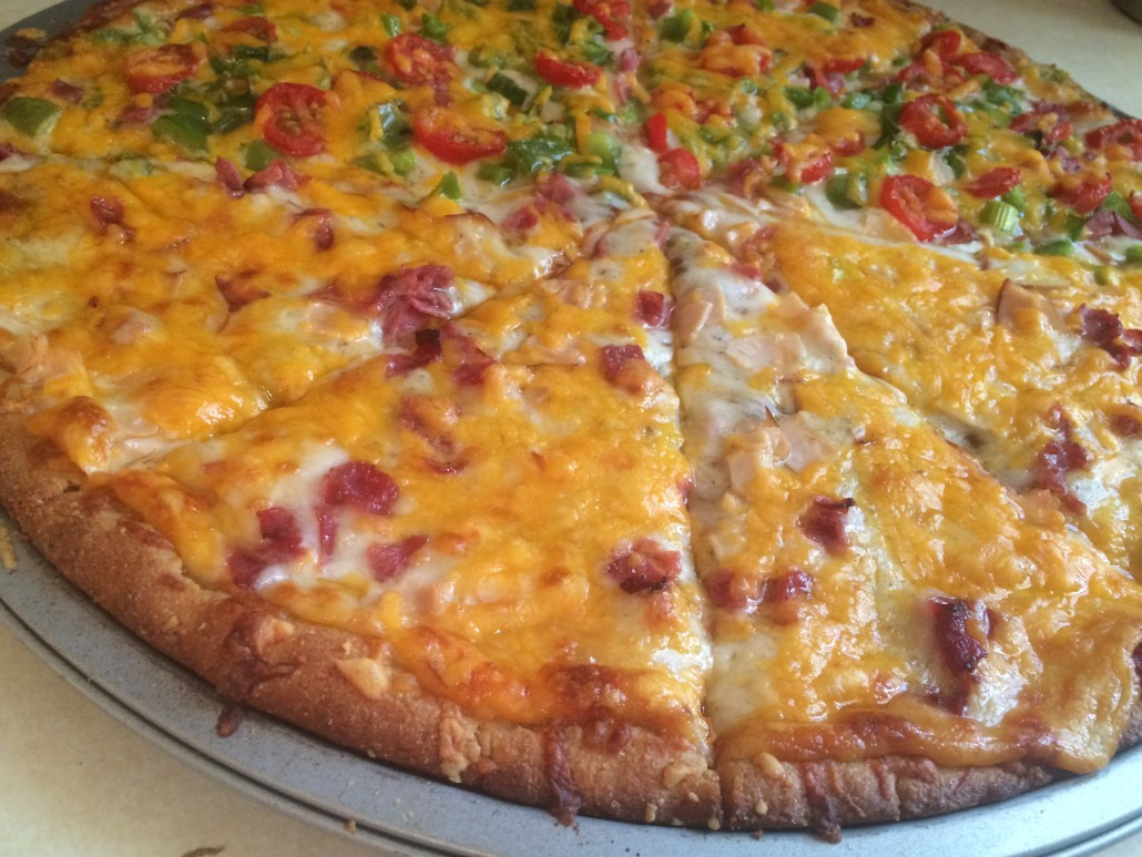 Half Lunch Meat Half Veggie Pizza with Cheddar Cheese
