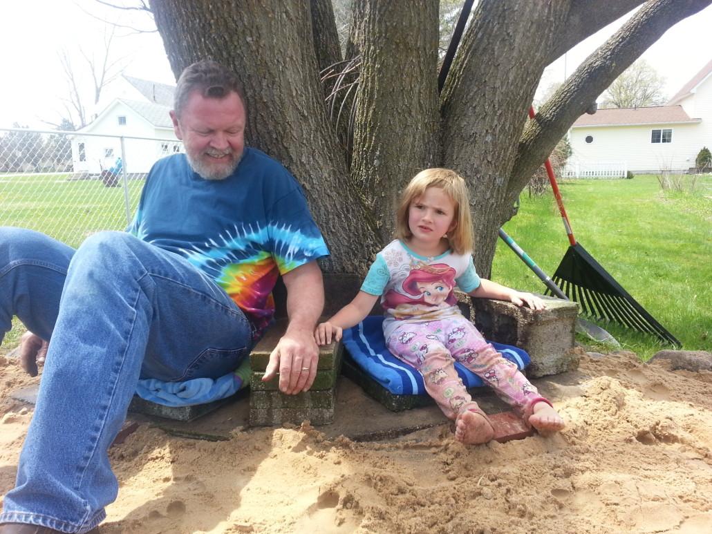 grandpa helps with the sandbox chairs