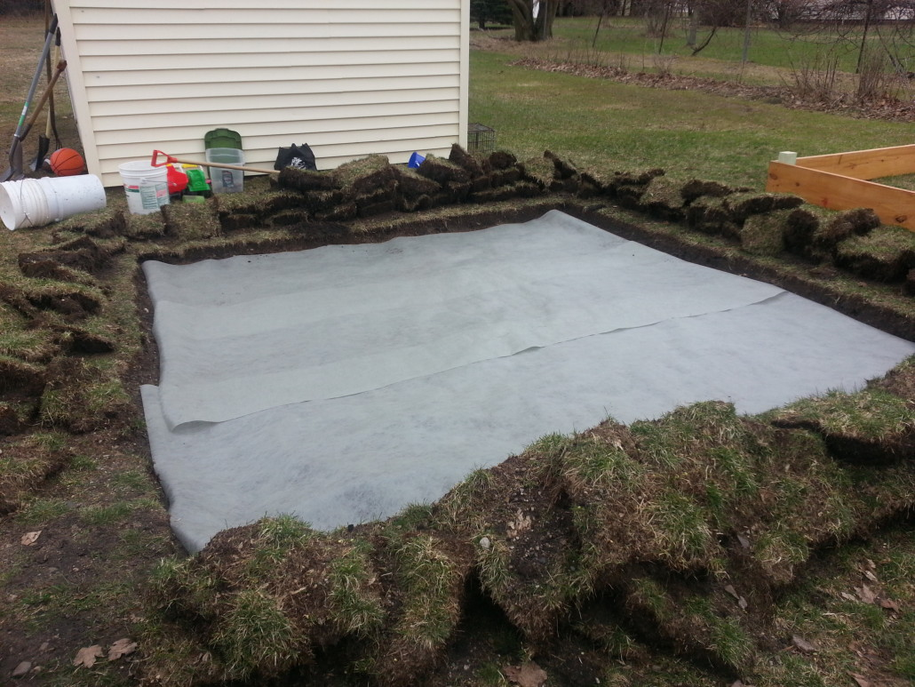 laying the weed blocker for the sandbox
