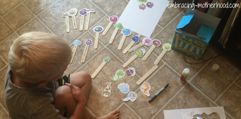 elliot with popsicle stick project