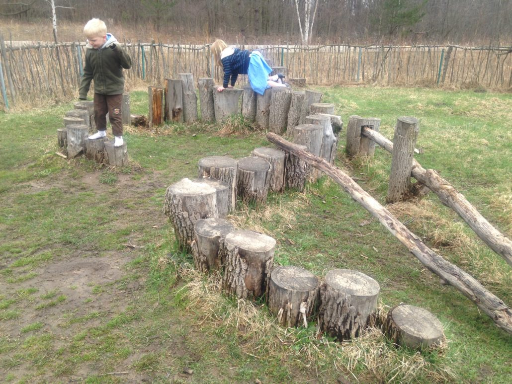 Ruby and Elliot Playing on Stepping Stumps at Blandford Nature Center