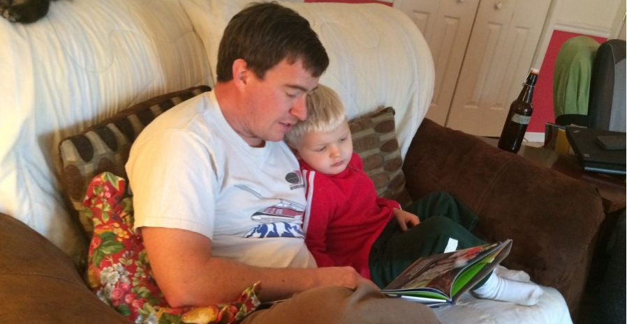 daddy reading with elliot