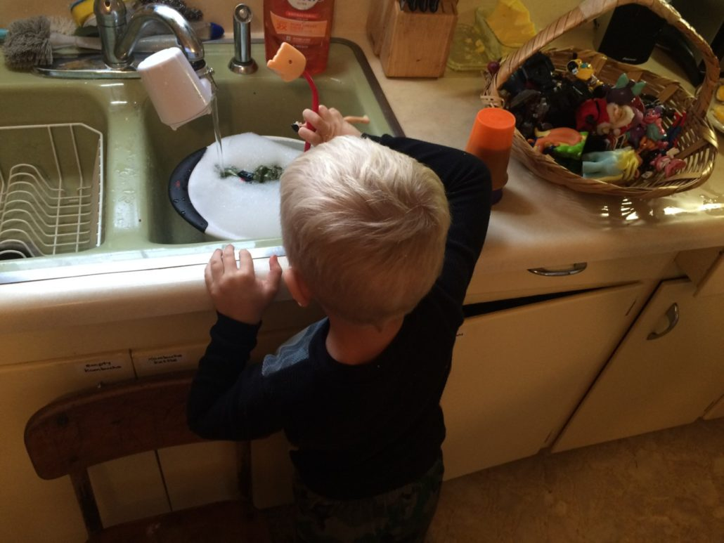 Elliot Doing Water Play in the Sink