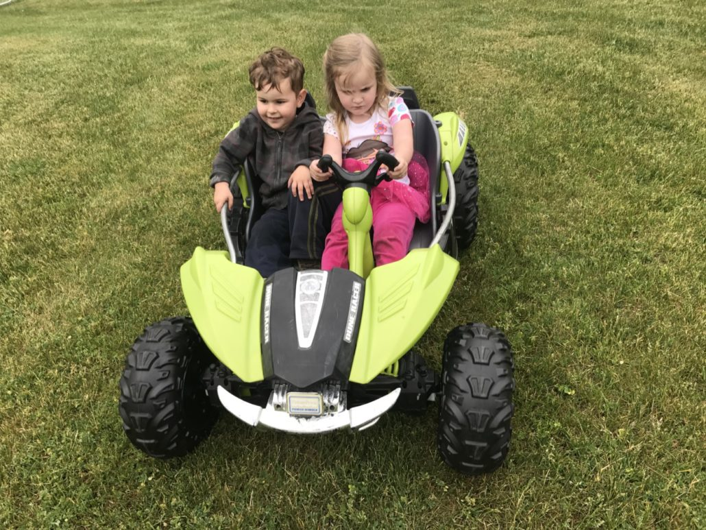 Julian and Ophelia in Battery Powered Car