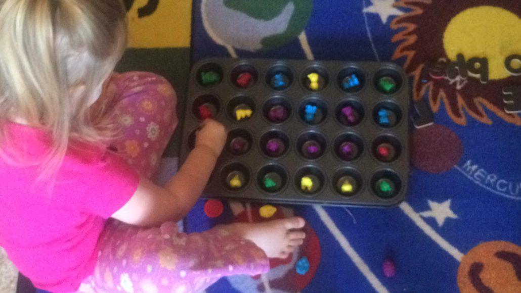 Ophelia Counting Bears in a Mini Muffin Tin