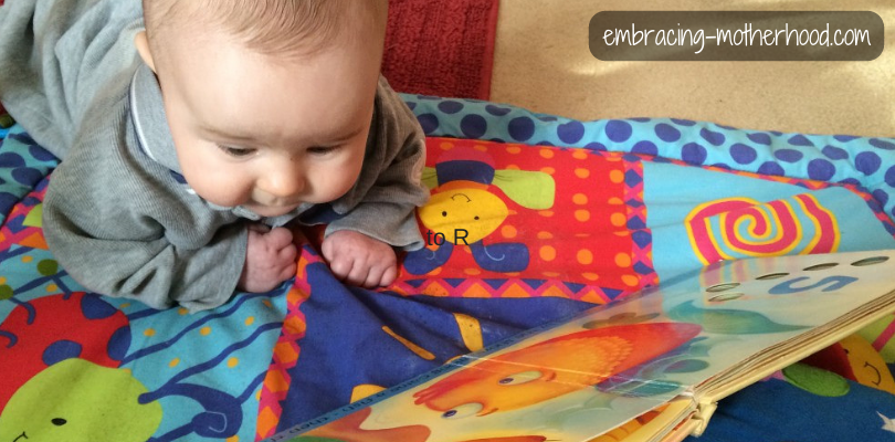 3 Month Old Julian Practicing Tummy Time While Looking at His Favorite Book
