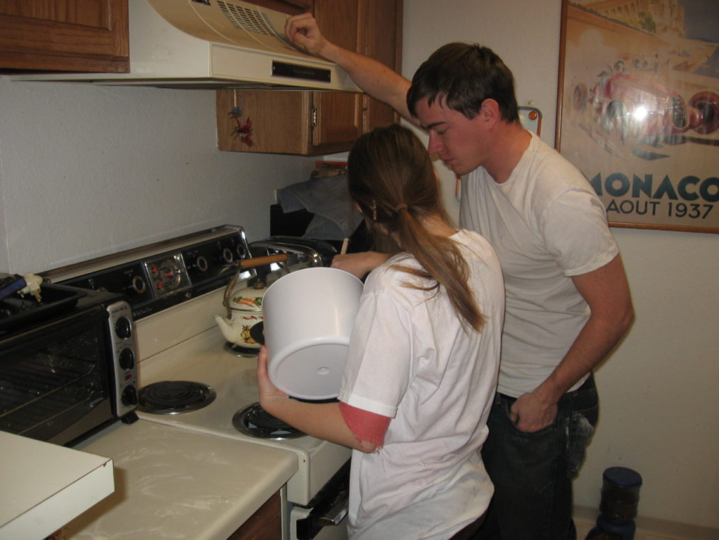 Scott is teaching his sister how to make bread in our old apartment back in 2006.