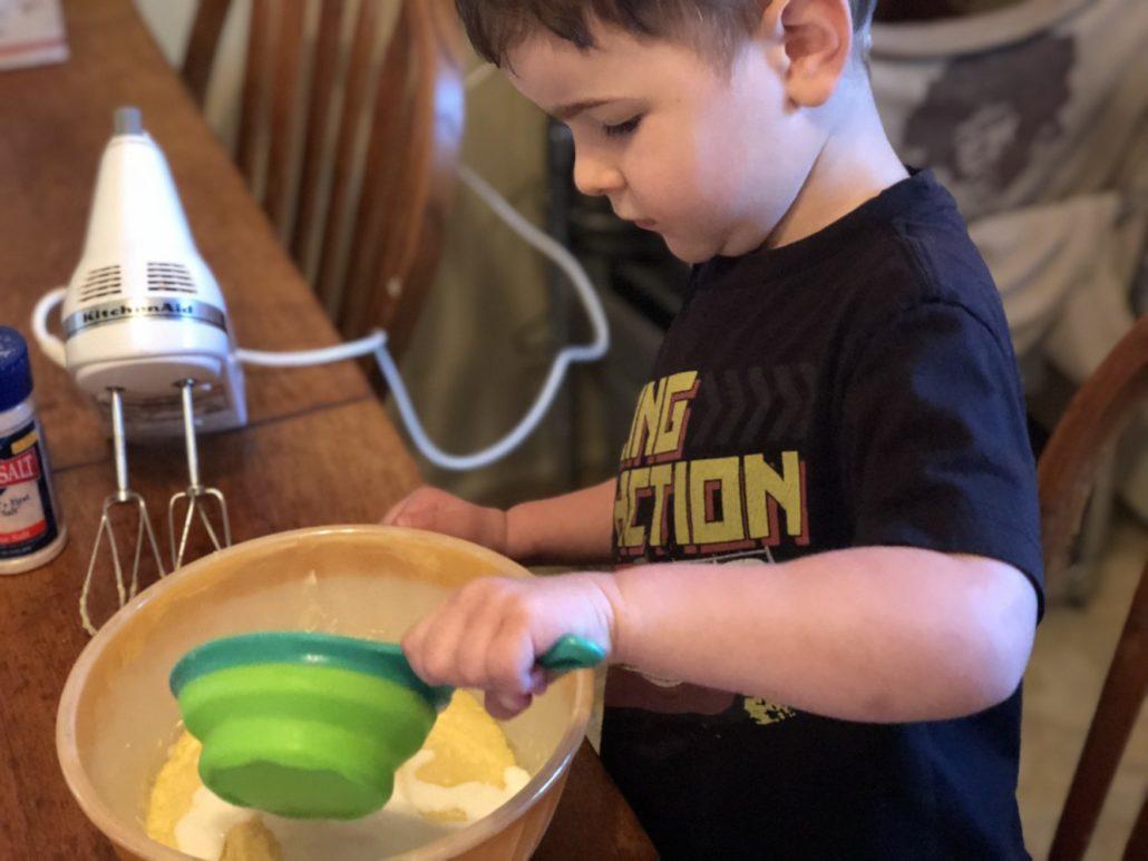 Julian Adding Flour to the Cupcakes