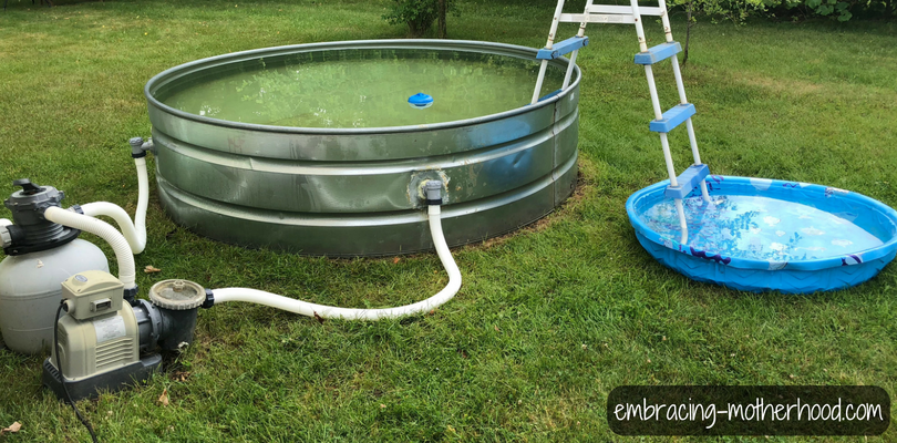 Stock Tank Pool and Sand Filter Filled with Water