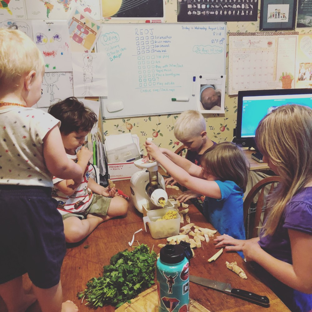 Kids Helping Me Juice Ginger, Tumeric, Cilantro, Lemons, and Limes for My Special Water
