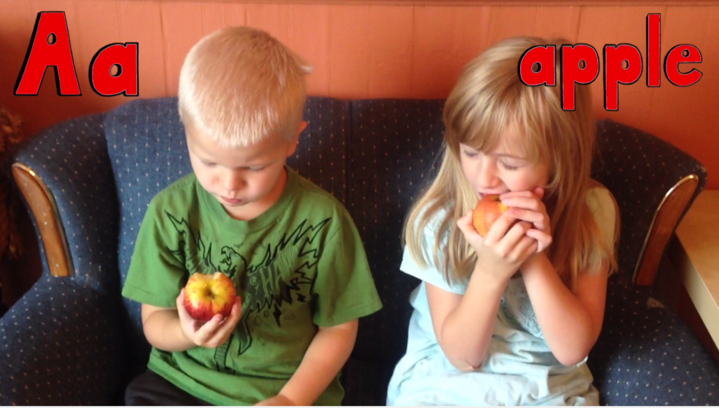 Elliot (4) and Ruby (6) Eating an Apple